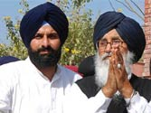 Parkash Singh Badal (R) greets people after the poll victory