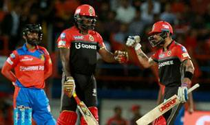 Chris Gayle and Virat Kohli (BCCI Photo)